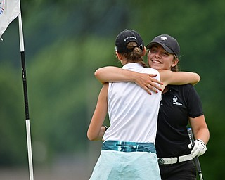 SALEM, OHIO - JULY 6, 2017: Victoria Messuri, white, gets a hug from Gillian Cerimele, black, both of Canfield, not he 18th green after they finished their rounds during the Vindy Greatest Golfer qualifying round at Salem Hills Golf Course, Thursday afternoon. DAVID DERMER | THE VINDICATOR