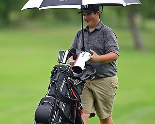 SALEM, OHIO - JULY 6, 2017: Nathan Cene of Austintown smile after seeing where his approach shot landed on the green, while under his umbrella, on the 11th hole during the Vindy Greatest Golfer qualifying round at Salem Hills Golf Course, Thursday afternoon. DAVID DERMER | THE VINDICATOR