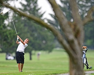 SALEM, OHIO - JULY 6, 2017: Patrick Howlett follows through on his approach shot on the 11th hole during the Vindy Greatest Golfer qualifying round at Salem Hills Golf Course, Thursday afternoon. DAVID DERMER | THE VINDICATOR