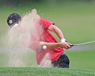 SALEM, OHIO - JULY 6, 2017: Dante Flak of Canfield chips out of the bunker on the 16th hole during the Vindy Greatest Golfer qualifying round at Salem Hills Golf Course, Thursday afternoon. DAVID DERMER | THE VINDICATOR