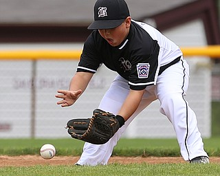 MICHAEL G TAYLOR | THE VINDICATOR-7-15-17  BASEBALL 8-10 yrs. Ohio D2 Championship- Boardman Spartans vs Canfield Cardinals at Field of Dreams in Boardman, OH. 1st,  Boardman's #4 Tyler Kirlik fields the ball and throw the runner out.
