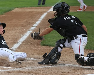 MICHAEL G TAYLOR | THE VINDICATOR-7-15-17  BASEBALL 8-10 yrs. Ohio D2 Championship- Boardman Spartans vs Canfield Cardinals at Field of Dreams in Boardman, OH. 2nd, Boardman's #42 Mikey Demetrios slides safely into home under the tag of Canfield #9 Dylan Mancini