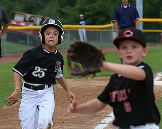 MICHAEL G TAYLOR | THE VINDICATOR-7-15-17  BASEBALL 8-10 yrs. Ohio D2 Championship- Boardman Spartans vs Canfield Cardinals at Field of Dreams in Boardman, OH. 2nd, Boardman's #25 Max Switka attempts to score as Canfield's #8 Noah Anzevino awaits the throw