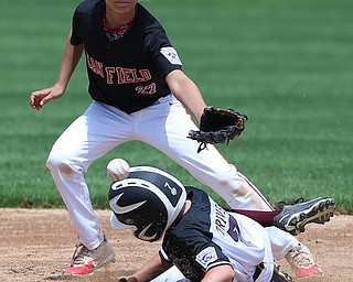 MICHAEL G TAYLOR | THE VINDICATOR-7-15-17  BASEBALL 8-10 yrs. Ohio D2 Championship- Boardman vs Canfield at Field of Dreams in Boardman, OH. 6th, Boardman's #7 Anthony Triveri steals 2nd under as  Canfield's#27 Zain Jadallah takes the throw