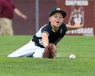 MICHAEL G TAYLOR | THE VINDICATOR-7-15-17  BASEBALL 8-10 yrs. Ohio D2 Championship- Boardman Spartans vs Canfield Cardinals at Field of Dreams in Boardman, OH. 2nd, Boardman's #42 Mikey Demetrios makes a diving attempt to catch the ball.