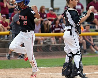 MICHAEL G TAYLOR | THE VINDICATOR-7-15-17  BASEBALL 8-10 yrs. Ohio D2 Championship- Boardman vs Canfield at Field of Dreams in Boardman, OH. 2nd, Canfield's #27 Zain Jadallah scores.
