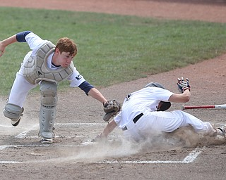 Baird Brothers catcher Connor Meyer (12) tags out Brooklyn Bonnie Paws pitcher Thomas Pallazoito (1) in the first inning as the Baird Brothers take on the Brooklyn Bonnie Paws in the 14u NABF World Series Championship, Sunday, July 16, 2017, at Cene Park in Struthers. Brooklyn won 2-0...(Nikos Frazier | The Vindicator)..