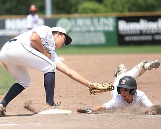 Baird Brothers first baseman Jake Gehring (9) tags out Brooklyn Bonnie Paws pitcher Thomas Pallazoito (1) in the sixth inning as the Baird Brothers take on the Brooklyn Bonnie Paws in the 14u NABF World Series Championship, Sunday, July 16, 2017, at Cene Park in Struthers. Brooklyn won 2-0...(Nikos Frazier | The Vindicator)..