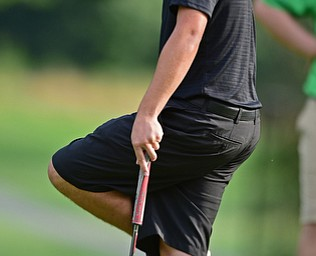 VIENNA, OHIO - JULY 21, 2017: Brandon Coffi shows his frustration after missing a putt on the 16th hole, Friday evening at Squaw Creek Country Club during round one of the 17u Vindicator's Greatest Golfer of the Valley Junior Tournament. DAVID DERMER | THE VINDICATOR