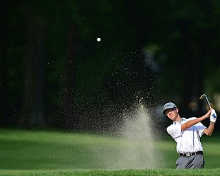 VIENNA, OHIO - JULY 21, 2017: Justin Atkinson of Brookfield chips out of the bunker on the 16th hole, Friday evening at Squaw Creek Country Club during round one of the 17u Vindicator's Greatest Golfer of the Valley Junior Tournament. DAVID DERMER | THE VINDICATOR