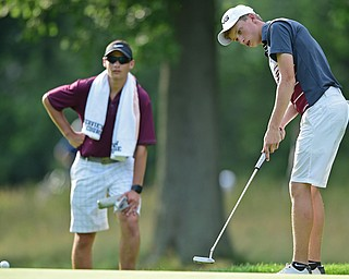 VIENNA, OHIO - JULY 21, 2017: Bobby Jonda of Boardman follows through on his putt on the 16th hole, Friday evening at Squaw Creek Country Club during round one of the 17u Vindicator's Greatest Golfer of the Valley Junior Tournament. DAVID DERMER | THE VINDICATOR