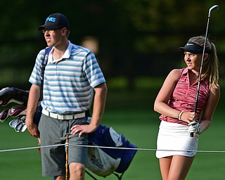 VIENNA, OHIO - JULY 21, 2017: Jenna Jacobson, right, and Zach of Poland watch the ball after her approach shot on the 16th hole, Friday evening at Squaw Creek Country Club during round one of the 17u Vindicator's Greatest Golfer of the Valley Junior Tournament. DAVID DERMER | THE VINDICATOR