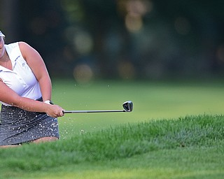 VIENNA, OHIO - JULY 21, 2017: Olivia Taylor of Niles chips out of the bunker on the 16th hole, Friday evening at Squaw Creek Country Club during round one of the 17u Vindicator's Greatest Golfer of the Valley Junior Tournament. DAVID DERMER | THE VINDICATOR