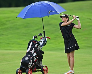 WARREN, OHIO - JULY 22, 2017: Jayne Bernard follows through on her approach shot on the 18th hole, Saturday afternoon at the Vindicator's Greatest Golfer of the Valley Jr. Championship at Avalon Lakes. DAVID DERMER | THE VINDICATOR