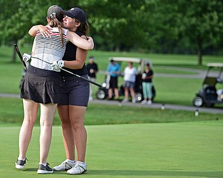 WARREN, OHIO - JULY 22, 2017: Gillian Cerimele, right, gets a hug from Hannah Keffler after they finished their round, Saturday afternoon at the Vindicator's Greatest Golfer of the Valley Jr. Championship at Avalon Lakes. DAVID DERMER | THE VINDICATOR