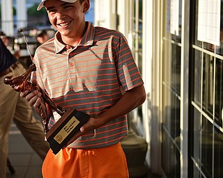 WARREN, OHIO - JULY 22, 2017: Jacob Sylak smiles after being presented his championship trophy, Saturday afternoon at the Vindicator's Greatest Golfer of the Valley Jr. Championship at Avalon Lakes. DAVID DERMER | THE VINDICATOR