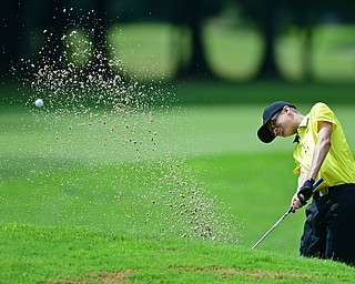 WARREN, OHIO - JULY 22, 2017: Justin Atkinson chips out of the bunker on the 14th hole, Saturday afternoon at the Vindicator's Greatest Golfer of the Valley Jr. Championship at Avalon Lakes. DAVID DERMER | THE VINDICATOR