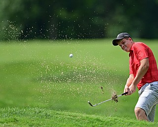 WARREN, OHIO - JULY 22, 2017: Joey Vitali chips out of the bunker on the 14th hole, Saturday afternoon at the Vindicator's Greatest Golfer of the Valley Jr. Championship at Avalon Lakes. DAVID DERMER | THE VINDICATOR