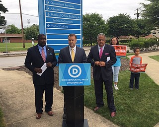 "Youngstown Democratic Mayoral Candidate Jamael ""Tito"" Brown, Ohio Democratic Party Chairman David Pepper and Mahoning County Democratic Party Chairman David Betras outside the Northside Medical Center protesting  an expected health care vote today in the U.S. Senate."