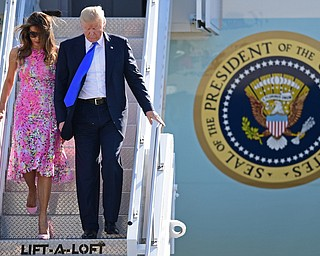 President Donald Trump walks, after exiting Air Force One, with first lady Melania Trump at the Youngstown-Warren Regional Airport, Tuesday, Tuesday, July 25, 2017, in Vienna, Ohio. Trump will be speaking at a rally Tuesday at the Covelli Centre in Youngstown, Ohio. (David Dermer/The Vindicator via AP)