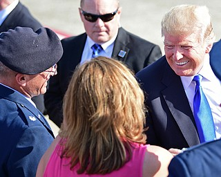 President Donald Trump smiles at the Youngstown-Warren Regional Airport, Tuesday, Tuesday, July 25, 2017, in Vienna, Ohio. Trump will be speaking at a rally Tuesday at the Covelli Centre in Youngstown, Ohio. (David Dermer/The Vindicator via AP)