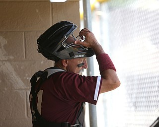 Boardman Fog  Tom Gaona (21) puts on his catchers mask during an over 50 baseball game between the Boardman Fog and Youngstown Astros at Boardman High School baseball field, Sunday, July 16, 2017 in Boardman...(Nikos Frazier | The Vindicator)
