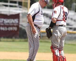 Youngstown Astros  Gill Geisel (31) and Youngstown Astros  Tom Murphy (29) talk during an over 50 baseball game between the Boardman Fog and Youngstown Astros at Boardman High School baseball field, Sunday, July 16, 2017 in Boardman...(Nikos Frazier | The Vindicator)
