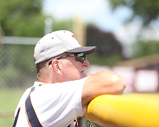 Youngstown Astros  Don Christian (24) watches the game from the dugout during an over 50 baseball game between the Boardman Fog and Youngstown Astros at Boardman High School baseball field, Sunday, July 16, 2017 in Boardman...(Nikos Frazier | The Vindicator)