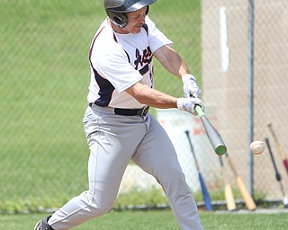 Youngstown Astros  Greg Sgera (28) connects during an over 50 baseball game between the Boardman Fog and Youngstown Astros at Boardman High School baseball field, Sunday, July 16, 2017 in Boardman...(Nikos Frazier | The Vindicator)