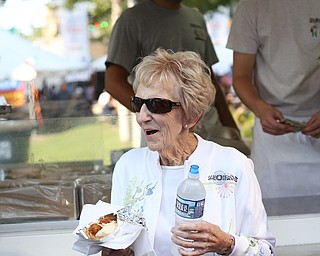 Jean Freaney of Canfield smiles as she walks away with a DiRusso's italian sausage sandwich during the Greater Youngstown Italian Festival, Saturday, August 5, 2017 in Downtown Youngstown...(Nikos Frazier | The Vindicator)