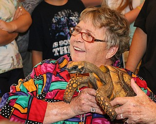 Barbara Lukas of Struthers holds a turtle during the Reptile and Amphibian show at the Mill Creek Farm in Canfield on Sunday afternoon.   Dustin Livesay     The Vindicator  8/6/17  Canfield