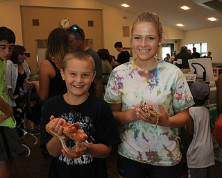Dylan (8) and Jocelyn (14) Washington of Hubbard pose for a picture with Snakes during the Reptile and Amphibian show at the Mill Creek Farm in Canfield on Sunday afternoon.   Dustin Livesay     The Vindicator  8/6/17  Canfield