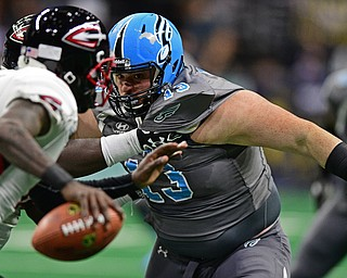 Philadelphia Soul defensive linemen Zach Zidian is held by Cleveland Gladiators offensive linemen Phillip-Keith Manley while chasing quarterback Arvell Nelson during their game on June 10, 2017 at the Wells Fargo Center in Philadelphia, Pennsylvania. DAVID DERMER | THE VINDICATOR