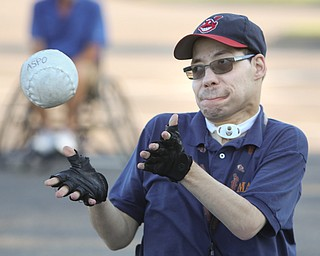 ROBERT K. YOSAY    THE VINDICATOR..Tom Glines of Youngstown makes a play at first as  The Adaptive Sports Program of Ohio - wheelchair softball - at the Covelli Centre parking lot