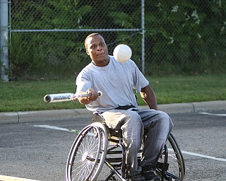 ROBERT K. YOSAY    THE VINDICATOR.Liston Spann of Youngstown prepares to tag the pitch... as  The Adaptive Sports Program of Ohio - wheelchair softball - at the Covelli Centre parking lot