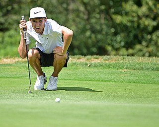 BOARDMAN, OHIO - AUGUST 18, 2017: Brandon Pluchinsky reads the green before attempting a putt on the 6th hole of the North Course, Friday afternoon during the Vindicator  Greatest Golfer Tournament. DAVID DERMER | THE VINDICATOR