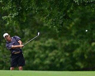 LIBERTY, OHIO - AUGUST 19, 2017: Don Newell follows through on his approach shot on the 11th hole, Saturday afternoon during the Vindy Greatest Golfer at Youngstown Country Club. DAVID DERMER | THE VINDICATOR