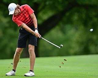 LIBERTY, OHIO - AUGUST 19, 2017: Dylan Portolese follows through on his approach shot on the 11th hole, Saturday afternoon during the Vindy Greatest Golfer at Youngstown Country Club. DAVID DERMER | THE VINDICATOR
