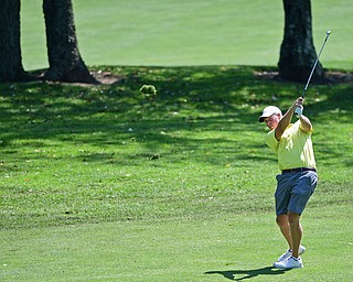POLAND, OHIO - AUGUST 20, 2017: Scott Jones follows through on his approach on the 1st hole during the final round of the Vindy Greatest Golf Tournament, Sunday afternoon at the Lake Club. DAVID DERMER   THE VINDICATOR