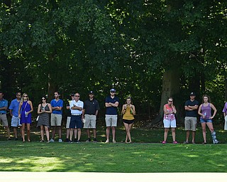 POLAND, OHIO - AUGUST 20, 2017: Members of the gallery watch as Brandon Pluchinsky reads the green on the 2nd hole during the final round of the Vindy Greatest Golf Tournament, Sunday afternoon at the Lake Club. DAVID DERMER | THE VINDICATOR