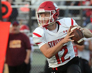 William D.Lewis The Vindicator  Struthers QB JD Hall(12) looks downfield during 1rst half action 8-25-17 at Liberty.