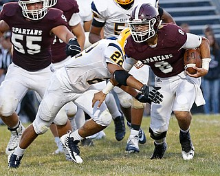 MICHAEL G TAYLOR | THE VINDICATOR-8-25-17 FOOTBALL Youngstown Golden Bears vs Boardman Spartans at Rayen Stadium, Youngstown, OH    2nd qtr.,  Boardman's #8 Michael O'Horo gains the 1st down as East''s #22 Mikese Stevens applies the hit.