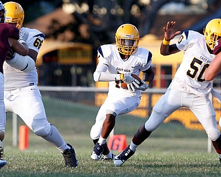 MICHAEL G TAYLOR | THE VINDICATOR-8-25-17 FOOTBALL Youngstown Golden Bears vs Boardman Spartans at Rayen Stadium, Youngstown, OH    1st qtr., East''s #15 Marcus Finkley runs for a 1st down.