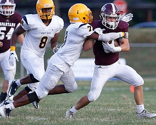 MICHAEL G TAYLOR | THE VINDICATOR-8-25-17 FOOTBALL Youngstown Golden Bears vs Boardman Spartans at Rayen Stadium, Youngstown, OH    1st qtr.,  Boardman's #6 Joe Ieraci is tackled by East''s #7 Jawan Showers.