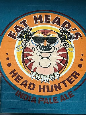 A huge mural on the wall at Fat Head's depicts the Head Hunter IPA logo.