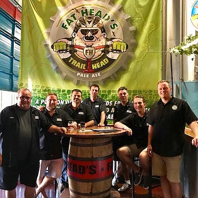 The Mahoning Valley Flight Crew and Fat Head's Jay Maratta at the Middleburg Heights production brewery.