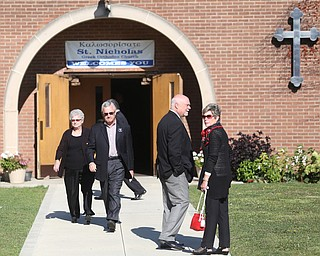 YSU President Jim Tressel(second left) and wife, Ellen Tressel(right) during former state Sen. Harry Meshel's funeral, Sept. 9, 2017, at St. Nicholas Greek Orthodox Church in Youngstown...(Nikos Frazier | The Vindicator)