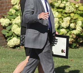 State Sen. Joe Schiavoni and wife, Margaret, walk into the church during former state Sen. Harry Meshel's funeral, Sept. 9, 2017, at St. Nicholas Greek Orthodox Church in Youngstown...(Nikos Frazier | The Vindicator)