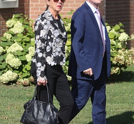 Former State Rep. Bob Hagan, and State Rep. Michele Lapore-Hagan walk into the church during former state Sen. Harry Meshel's funeral, Sept. 9, 2017, at St. Nicholas Greek Orthodox Church in Youngstown...(Nikos Frazier | The Vindicator)
