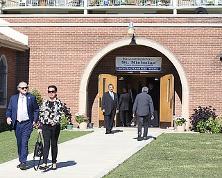 Former State Rep. Bob Hagan, and State Rep. Michele Lapore-Hagan exit the church during former state Sen. Harry Meshel's funeral, Sept. 9, 2017, at St. Nicholas Greek Orthodox Church in Youngstown...(Nikos Frazier | The Vindicator)